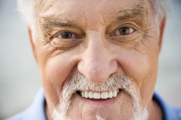 Portrait close up of a senior man smiling
