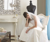 An unhappy bride sitting on a chair