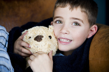 portrait little boy and teddy bear