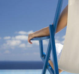 A woman relaxing in a deck chair