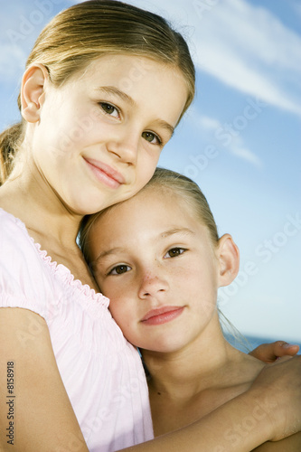 Two young girls embracing