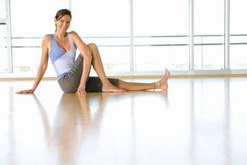 Woman doing yoga in exercise studio, portrait