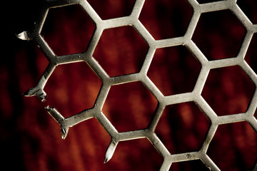 Metal Background hex pattern on red