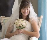 A bride sitting on a chair