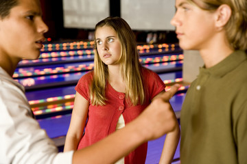 Argument between teenage boys in a bowling alley