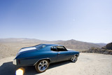 Classic car in desert (lens flare)