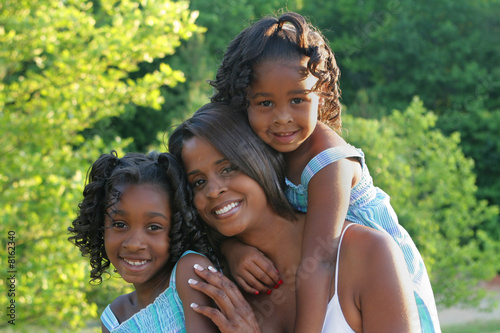A woman and her daughters
