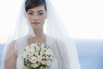 Portrait of a bride holding her bouquet