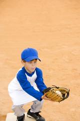 Young boy catching baseball