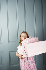 little girl carrying presents