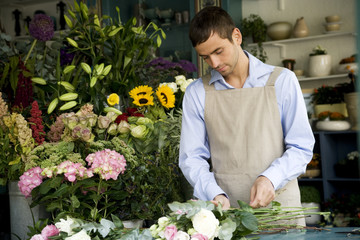 Male florist creating a bouquet of flowers