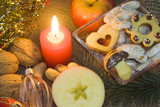 Christmas atmosphere - candle, apple, sweets poster