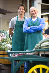 Green grocers by shop, smiling, portrait