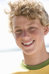 Teenage boy (13-15) smiling, portrait, close-up