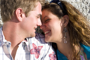 Young couple smiling at each other, close-up