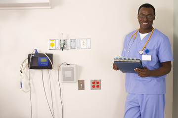 Doctor with folder and stethoscope, smiling, portrait