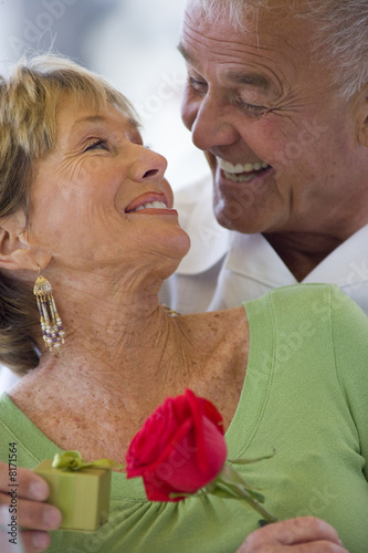Senior couple smiling at each other, close-up