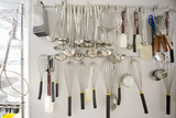 Kitchen utensils hanging from wall