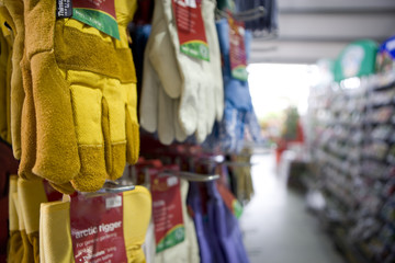 Protective gloves hanging in shop