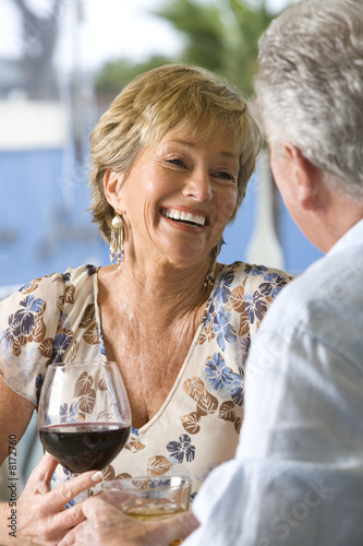 Couple with drinks, smiling