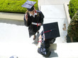Female graduates in conversation, in caps and gowns, elevated view
