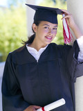 Graduate, hand on cap, portrait