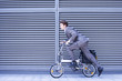 Businessman on bicycle, side view