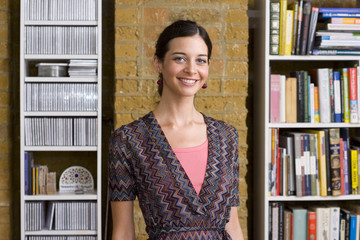 Woman in office, smiling, portrait