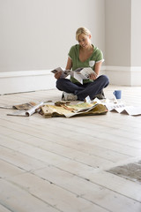 Woman decorating, looking at colour swatches