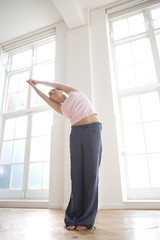 Woman stretching, low angle view