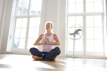 Woman meditating, low angle view