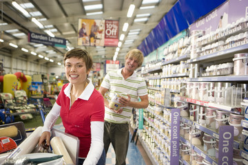 Couple in hardware store, smiling, portrait