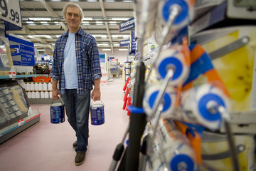 Man in hardware store, low angle view