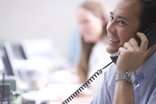 Businessman on telephone, smiling