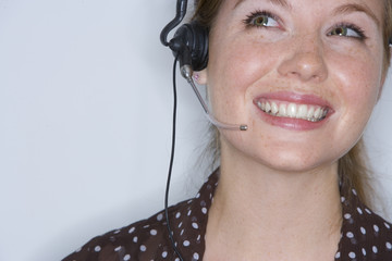 Woman with headset, smiling