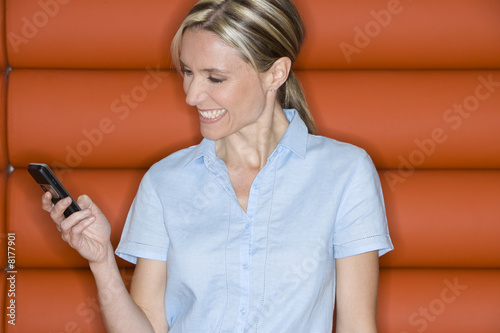 Woman with mobile phone, smiling