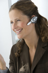 Businesswoman with hands-free cell phone headset