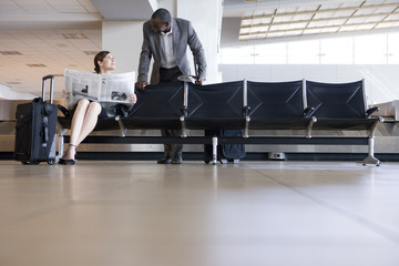 Business people in airport waiting area