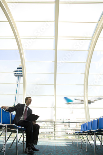 Businessman in airport waiting area