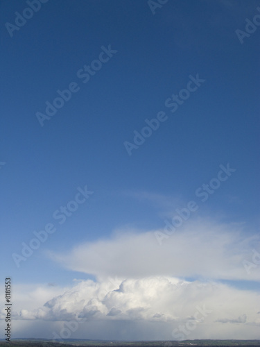 Blue sky and clouds over rolling landscape