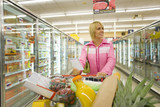 Woman grocery shopping in frozen food section