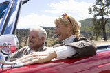 Couple on road trip in convertible