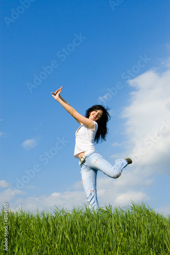 expressive young woman is jumping