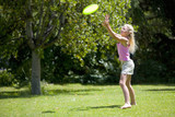 Girl (8-10) catching flying disc outdoors