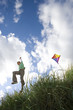 Boy (7-9 years) flying kite outdoors, low angle view