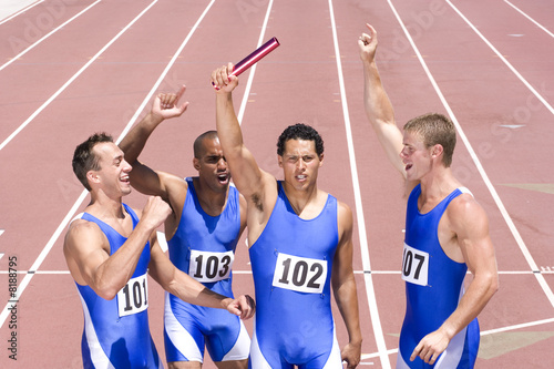 Group of male athletes with arms raised in celebration, elevated view