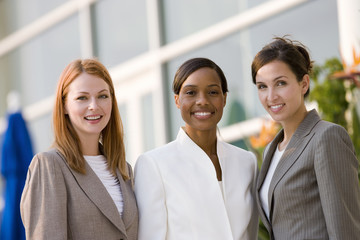 Three businesswomen smiling, portrait