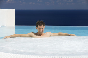 A man relaxing in a jacuzzi