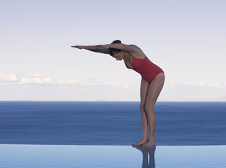 A woman preparing to dive into a pool