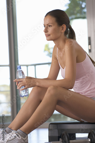 A woman sitting in a gym